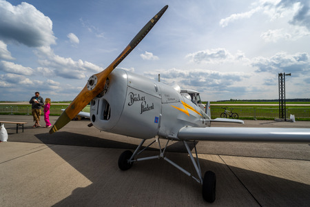BERLIN - APRIL 27, 2018: Two-seat sporttraining monoplane Bucker Bu 180 Student. Exhibition ILA Berlin Air Show 2018.