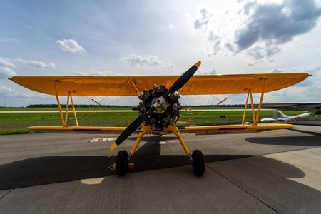 BERLIN - APRIL 27, 2018: The biplane trainer Boeing-Stearman Model 75 Kaydet. Exhibition ILA Berlin Air Show 2018. Editorial