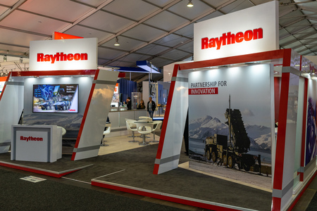 BERLIN - APRIL 27, 2018: Pavilion Defense and Security, stand of Raytheon Company, a major U.S. defense contractor. Exhibition ILA Berlin Air Show 2018.