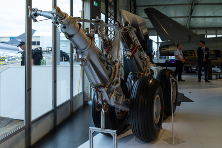 BERLIN - APRIL 27, 2018: Pavilion Defense and Security. The main landing gear of military transport aircraft Transall C-160. Exhibition ILA Berlin Air Show 2018. Editorial