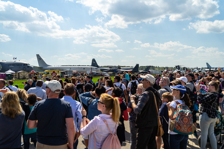 BERLIN - APRIL 28, 2018: Visitors to the exhibition on the airfield. Exhibition ILA Berlin Air Show 2018.