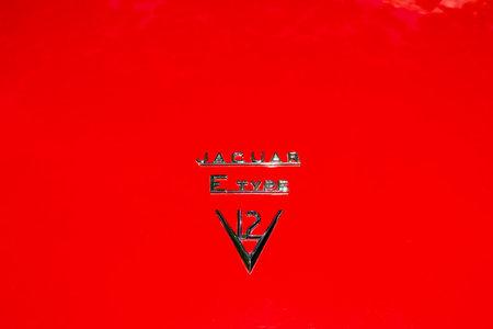 BERLIN - JUNE 09, 2018: The emblem of the sports car Jaguar E-Type. Classic Days Berlin 2018. Publikacyjne