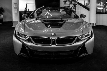 BERLIN - JUNE 09, 2018: Showroom. A plug-in hybrid sports car BMW i8 Roadster. Black and white.