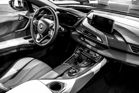 BERLIN - JUNE 09, 2018: Showroom. Interior of a plug-in hybrid sports car BMW i8 Roadster. Black and white.