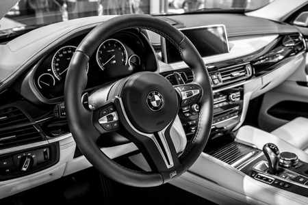 BERLIN - JUNE 09, 2018: Showroom. Interior of a mid-size luxury crossover SUV BMW X6 M. Black and white.