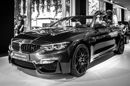 BERLIN - JUNE 09, 2018: Showroom. Compact executive car/Sports car BMW M4 Cabrio. Black and white. Editorial