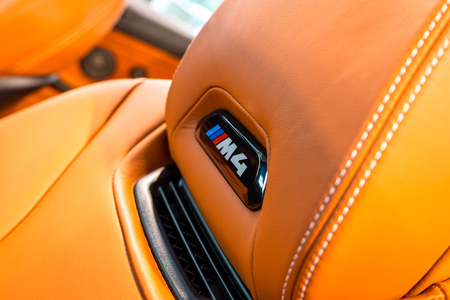 BERLIN - JUNE 09, 2018: Showroom. Detail of leather upholstery of an armchair with an emblem of a compact executive/Sports car BMW M4 Cabrio. Editorial