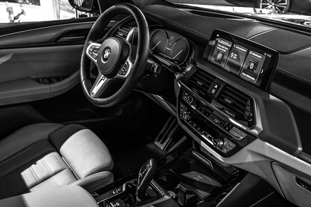 BERLIN - JUNE 09, 2018: Showroom. Interior of compact luxury crossover SUV BMW X3. Black and white. Éditoriale