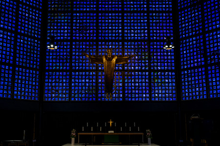 BERLIN - JUNE 09, 2018: Interior of Kaiser Wilhelm Memorial Church (modern building) on the Breitenbachplatz. Crucified Jesus Christ, by architect Karl Hemmeter. Editorial
