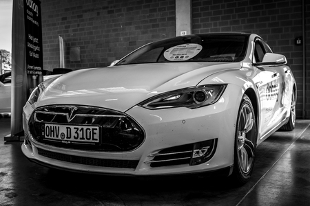PAAREN IM GLIEN, GERMANY - MAY 19, 2018: The mid-size luxury all-electric five-door liftback car Tesla Model S. Black and white. Die Oldtimer Show 2018.