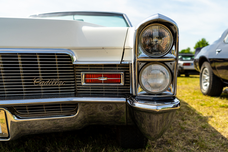 PAAREN IM GLIEN, GERMANY - MAY 19, 2018: Headlamp of a full-size luxury car Cadillac de Ville convertible (third generation), 1968. Die Oldtimer Show 2018.