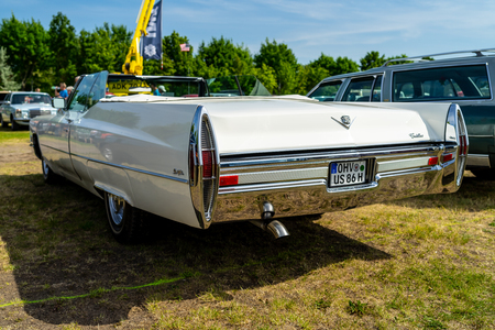 PAAREN IM GLIEN, GERMANY - MAY 19, 2018: Full-size luxury car Cadillac de Ville convertible (third generation), 1968. Rear view. Die Oldtimer Show 2018.