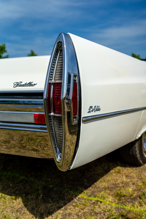 PAAREN IM GLIEN, GERMANY - MAY 19, 2018: Rear stoplights of a full-size luxury car Cadillac de Ville convertible (third generation), 1968. Die Oldtimer Show 2018.
