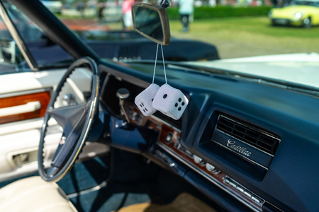 PAAREN IM GLIEN, GERMANY - MAY 19, 2018: Decoration in the cabin of a full-size luxury car Cadillac de Ville convertible (third generation), 1968. Focus on the foreground. Die Oldtimer Show 2018.