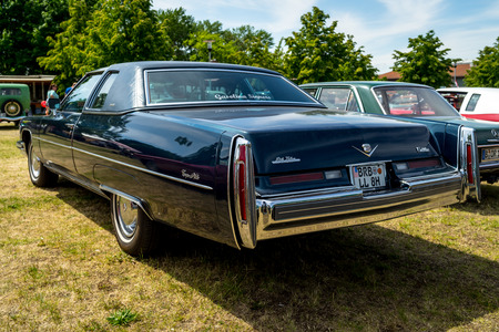 PAAREN IM GLIEN, GERMANY - MAY 19, 2018: Full-size luxury car Cadillac Coupe de Ville (fourth generation), 1974. Rear view. Die Oldtimer Show 2018.