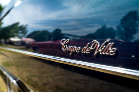 PAAREN IM GLIEN, GERMANY - MAY 19, 2018: Fragment of the full-size luxury car Cadillac Coupe de Ville (fourth generation), 1974. Die Oldtimer Show 2018.