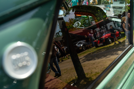PAAREN IM GLIEN, GERMANY - MAY 19, 2018: Interior of a compact car Saab 96. Abstraction. View through the glass, reflections. Die Oldtimer Show 2018. 写真素材 - 114452630
