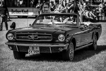 PAAREN IM GLIEN, GERMANY - MAY 19, 2018: Pony car Ford Mustang convertible, 1964. Black and white. Die Oldtimer Show 2018.