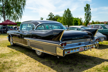 PAAREN IM GLIEN, GERMANY - MAY 19, 2018: Full-size luxury car Cadillac Sixty Special, 1958. Rear view. Die Oldtimer Show 2018.