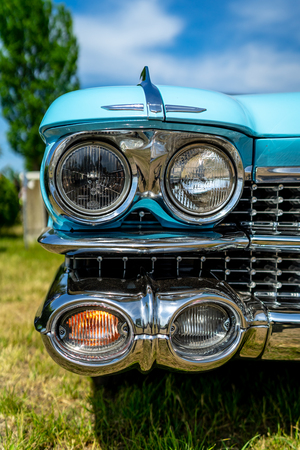 PAAREN IM GLIEN, GERMANY - MAY 19, 2018: Headlamp of a full-size luxury car Cadillac Coupe de Ville, 1960. Die Oldtimer Show 2018. Editoriali