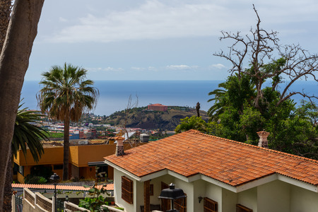LA OROTAVA, TENERIFE, CANARY ISLANDS, SPAIN - JULY 25, 2018: Streets of the historic center of the old town. In the background is the Atlantic Ocean and the city of Puerto de la Cruz. Editorial