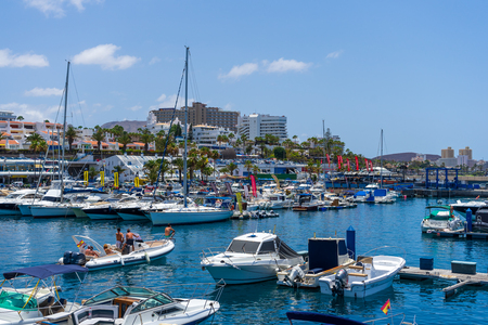 COSTA ADEJE, TENERIFE, CANARY ISLANDS, SPAIN - JULY 26, 2018: Sea port and marina for boats and yachts.