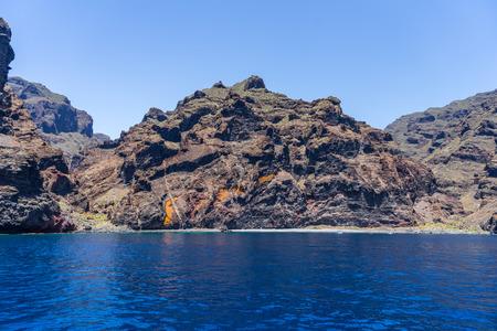 Vertical cliffs Acantilados de Los Gigantes (Cliffs of the Giants). View from Atlantic Ocean. Tenerife. Canary Islands. Spain.