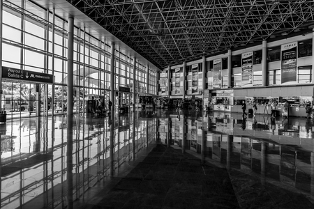 SANTA CRUZ, CANARY ISLANDS, SPAIN - JULY 28, 2018: Interior of a modern long-distance bus station. Black and white. Éditoriale