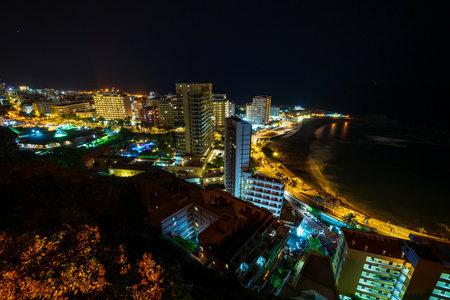 PUERTO DE LA CRUZ, CANARY ISLANDS, SPAIN - JULY 30, 2018: A view of the night city from a height. Viewpoint: Mirador La Paz.