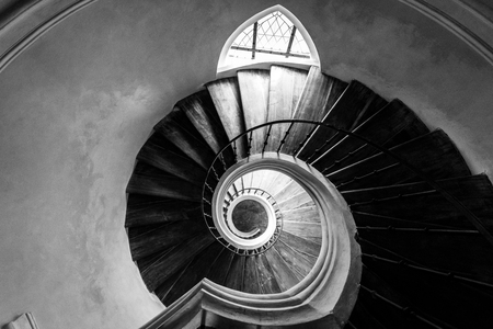 Old spiral staircase. View from above. Black and white. Stock Photo