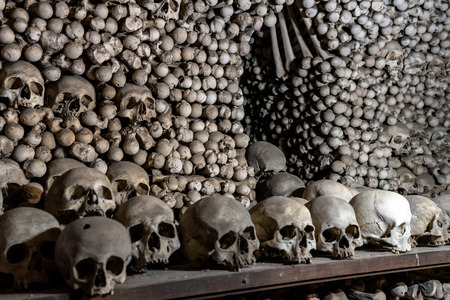 KUTNA HORA, CZECH REPUBLIC - OCTOBER 26, 2018: Detail of interior of Sedlec Ossuary, a small Roman Catholic chapel, located beneath the Cemetery Church of All Saints. Black and white.