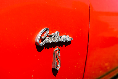 BERLIN - MAY 05, 2018: Emblem of personal luxury car Oldsmobile Cutlass S. Close-up.