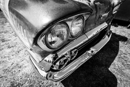 BERLIN - MAY 05, 2018: Headlamp of the full-size car Chevrolet Bel Air (Third generation). Black and white.