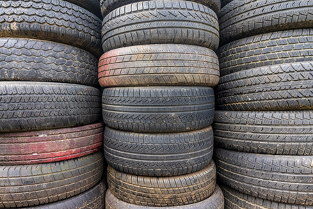 Old and used car tires. Background.