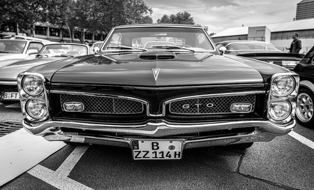 BERLIN - MAY 11, 2019: Muscle car Pontiac GTO, (first generation). Black and white. 32th Berlin-Brandenburg Oldtimer Day. Stock Photo - 124337529