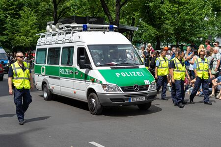 BERLIN - JUNE 09, 2019: The annual Carnival of Cultures (Karneval der Kulturen) celebrated around the Pentecost weekend. A police security check before the parade.