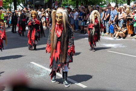 BERLIN - JUNE 09, 2019: The annual Carnival of Cultures (Karneval der Kulturen) celebrated around the Pentecost weekend. Participants carnival on the street.