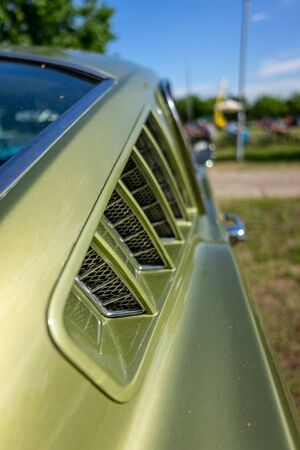 PAAREN IM GLIEN, GERMANY - JUNE 08, 2019: Ventilation grille of pony car Ford Mustang (first generation), close-up. Die Oldtimer Show 2019.