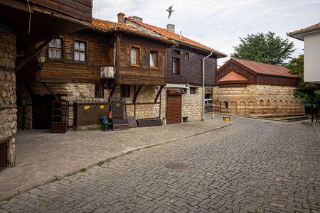 Street of old town. Church of Saint Paraskevi of Iconium (also known as Paraskeva Pyatnitsa) in the background. Nessebar. Bulgaria.