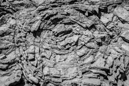 Sedimentary rock. Structure of natural stone. Background. Black and white.