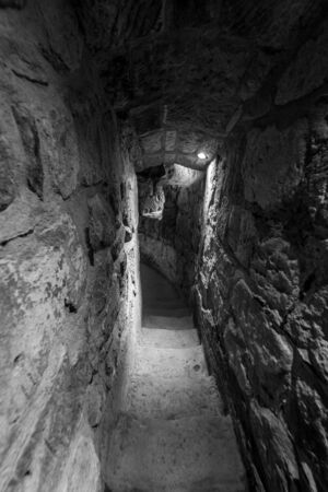 Narrow passage inside the fortress wall. Black and white.