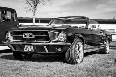 PAAREN IM GLIEN, GERMANY - OCTOBER 03, 2020: Pony car Ford Mustang (first generation). Black and white. Die Oldtimer Show 2020.