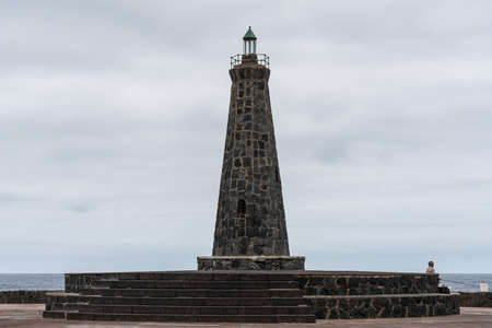 Bajamar, Tenerife. Canary Islands, Spain. Lighthouse on the waterfront of a small tourist town in the north of Tenerife.