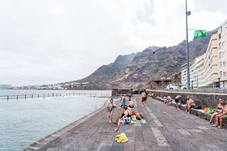 BAJAMAR, CANARY ISLANDS, TENERIFE - JULY 06, 2021: Promenade with a beach in a small town in the north of Tenerife.