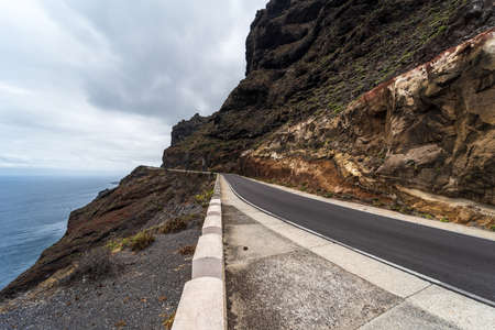 High mountain road at the edge of the ocean. Standard-Bild