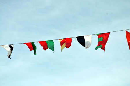flapping: medieval flag pennants flapping in the sky Stock Photo
