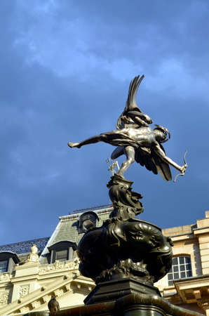 angels fountain: Statue of Eros at Picadilly Circus, London, blue sky
