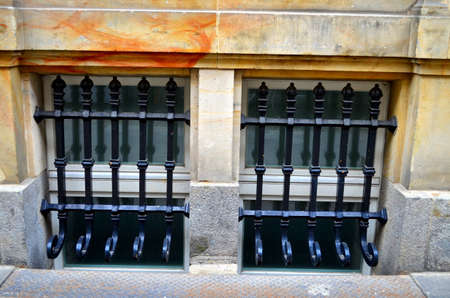window with metal bars on street level