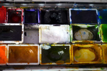 paintbox: closup of a messy paintbox after using Stock Photo