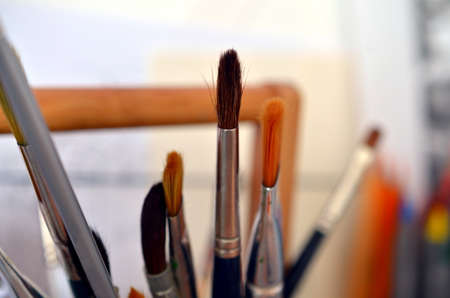 bunch of different brushes of a painter